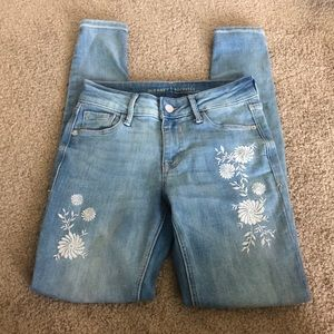 Light blue ripped skinny with flower pattern